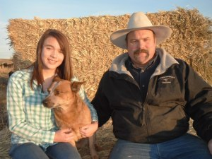 Larry and two of his ranch hands: daughter Dakota and his dog Festus