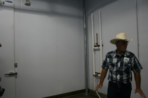 LPCA director Wade King gives a tour of the facility, where he stands near a sanitation area. The facility was developed in consultation with Washington State University and other organizations to account for the best animal and human safety measures.