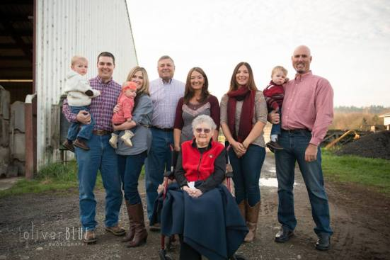 From left: My brother, sister in law, nephew & niece, my parents, me, RB & Rancher. Out front is the original farm wife, my grandmother Dorothy who is 97 years young.   Photo taken where I grew up, Elliott Farm & Livestock, Kent, WA.