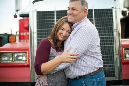 Farmer Bruce and Farmer Heidi. They wanted their photo in front of their dump truck. Love my folks.